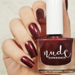 Pearly dark red manicure